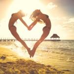 women jumping in heart